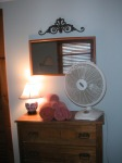 The dresser in my bedroom. There's no air conditioning, but the fact that the place is nestled in the trees makes a difference, so the fan blowing on me works just fine!