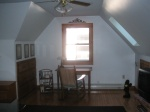 This is a long view of the attic. I love it -- it's so reminiscent of Poe's attic in Baltimore, and Mailer's attic here in Ptown. In both cases, the writing desk faces the window at the end of the room.