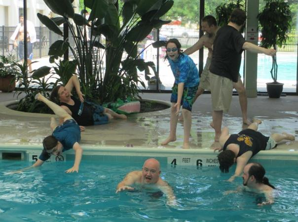 Panel in the Pool participants clamber to escape an alligator (I'll explain later).