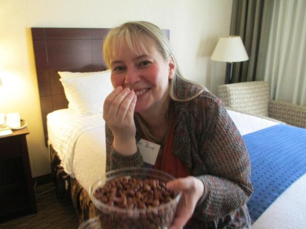 14 8Pi-Con And after all that work, Terri and I needed a break. Here she has some yummy almonds. I am off-camera, having a glass of wine.