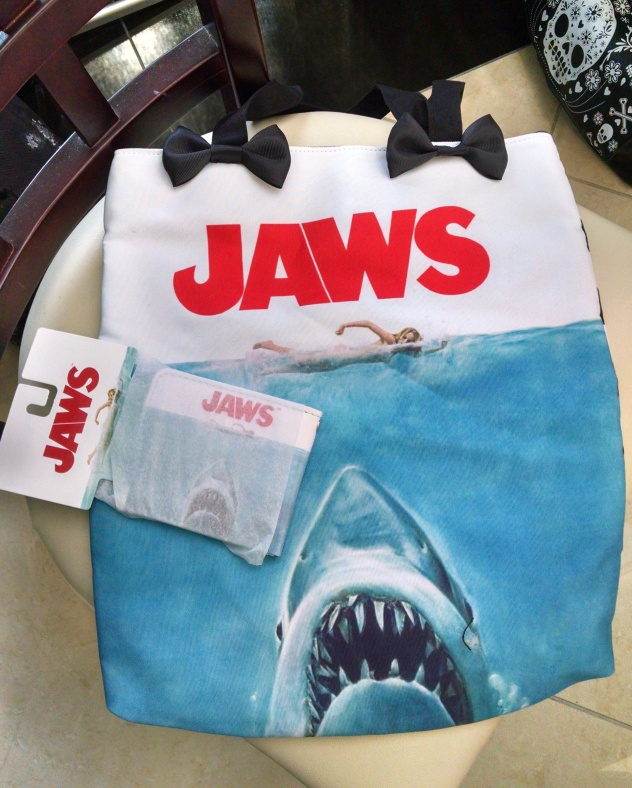 Because I just don't have enough JAWS crap. The vendors there had such a wonderful variety of things! I got this beach bag, and Nathan got a JAWS wallet, at Necrosuit. Check out their scary inventory at Necrosuit.com!