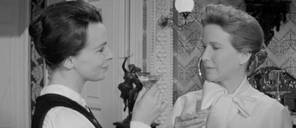 In The Haunting, Claire Bloom, left, and Julie Harris have drinks in their hands on several occasions.