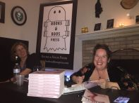 Signing copies of The Shadows Behind