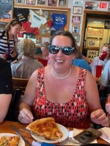 Krissi wears Shark Week glasses