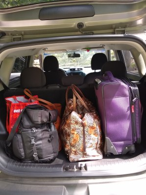 Car packed with suitcases